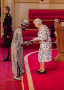 Imrana receiving his award from the Queen of England
