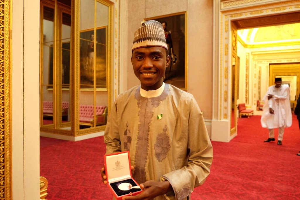 Imrana with his Medal at the Buckingham palace
