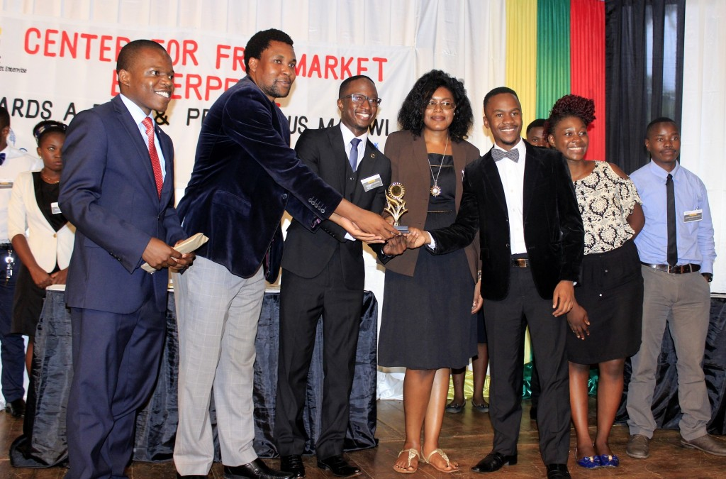 Peter Yakobe awarding winners of 2016 inter-varsity debate