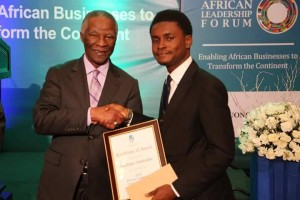 Adekunle Adepajo receiving his award from Thabo Mbeki, former South Africa President.